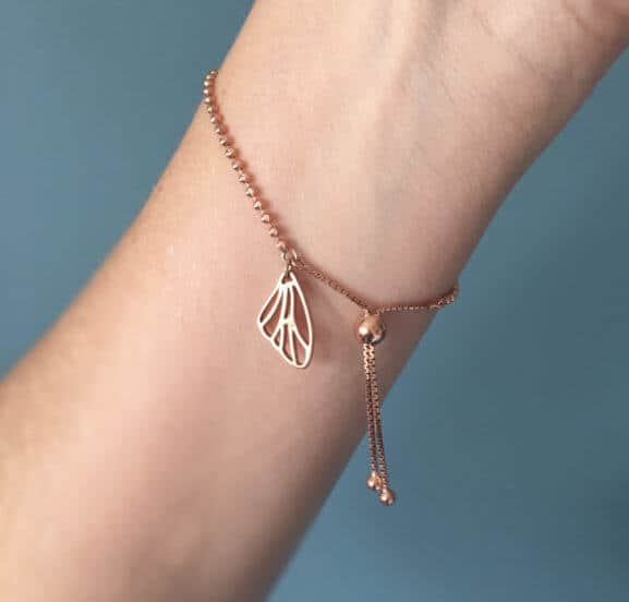 Papillon Belle bracelet with butterfly skeleton wing charm in rose gold with rope tie